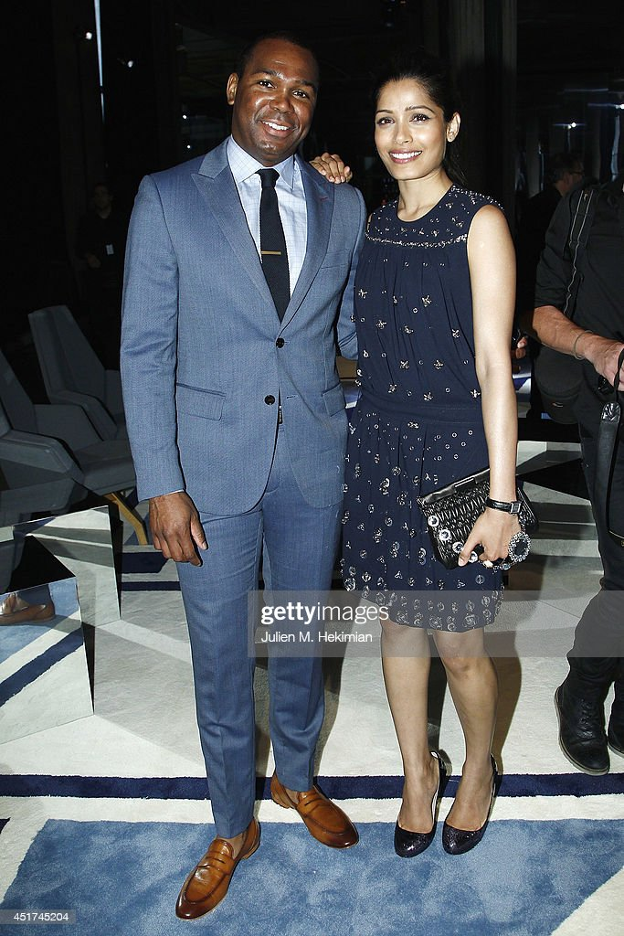 <a gi-track='captionPersonalityLinkClicked' href=/galleries/search?phrase=Freida+Pinto&family=editorial&specificpeople=5518973 ng-click='$event.stopPropagation()'>Freida Pinto</a> and guest attend the Miu Miu Resort Collection 2015 at Palais d'Iena on July 5, 2014 in Paris, France.