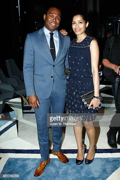 Freida Pinto and guest attend the Miu Miu Resort Collection 2015 at Palais d'Iena on July 5 2014 in Paris France