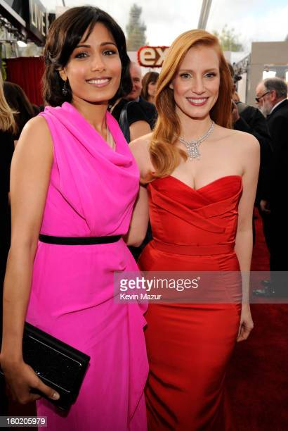 Freida Pinto and Jessica Chastain attend the 19th Annual Screen Actors Guild Awards at The Shrine Auditorium on January 27 2013 in Los Angeles...