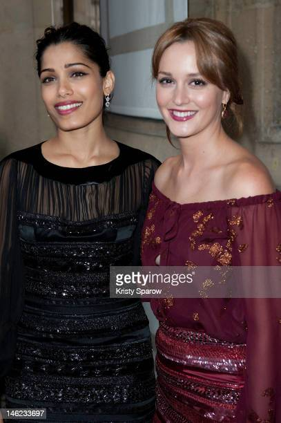 Freida Pinto and Leighton Meester attend the Salvatore Ferragamo Cruise Collection 2013 show presented at Galerie Denon at the Louvre Museum on June...