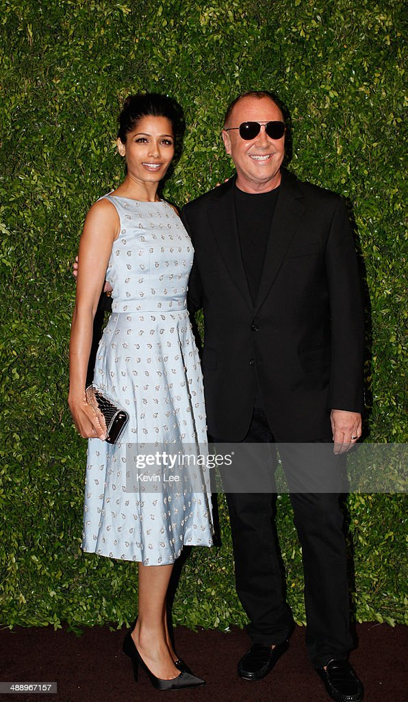 Freida Pinto and Michael Kors poses for a picture after the Michael Kors fashion show on May 9, 2014 in Shanghai, China.