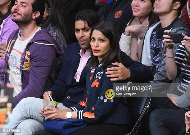 Freida Pinto and Ronnie Bacardi attend a basketball game between the Milwaukee Bucks and the Los Angeles Lakers at Staples Center on December 15 2015...