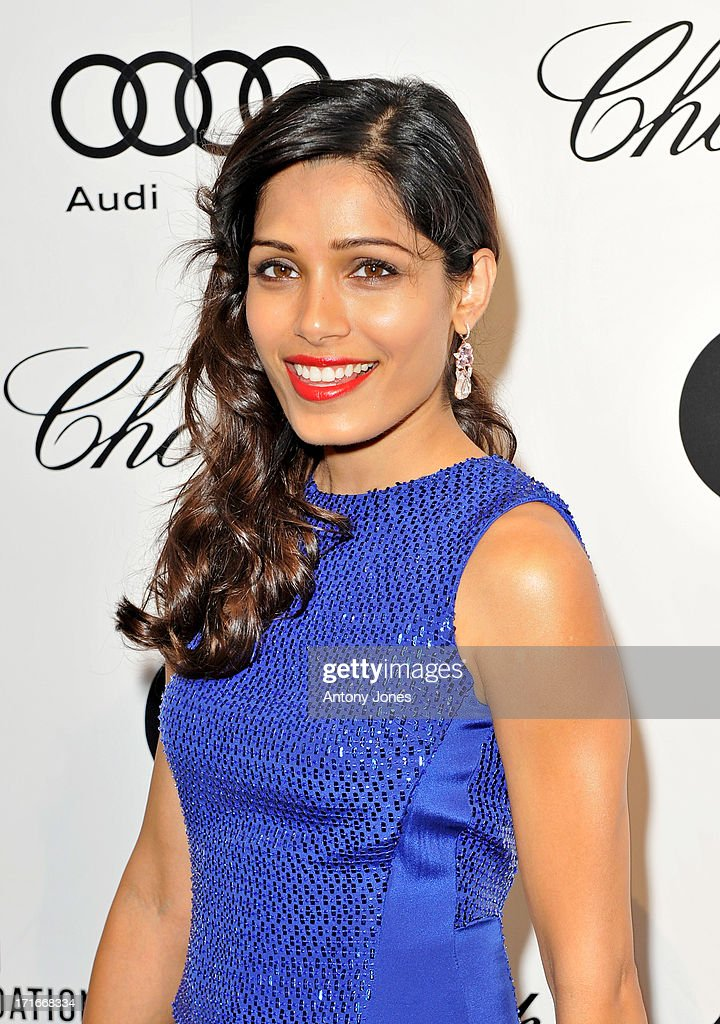 Freida Pinto attends the 15th Annual White Tie and Tiara Ball to Benefit Elton John AIDS Foundation in Association with Chopard at Woodside on June 27, 2013 in Windsor, England. No sales to online/digital media worldwide until the 14th of July. No sales before July 14th, 2013 in UK, Spain, Switzerland, Mexico, Dubai, Russia, Serbia, Bulgaria, Turkey, Argentina, Chile, Peru, Ecuador, Colombia, Venezuela, Puerto Rico, Dominican Republic, Greece, Canada, Thailand, Indonesia, Morocco, Malaysia, India, Pakistan, Nigeria. All pictures are for editorial use only and mention of 'Chopard' and 'The Elton John Aids Foundation' are compulsory. No sales ever to Ok, Now, Closer, Reveal, Heat, Look or Grazia magazines in the United Kingdom. No sales ever to any jewellers or watchmakers other than Chopard