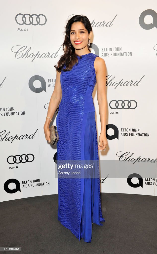 <a gi-track='captionPersonalityLinkClicked' href=/galleries/search?phrase=Freida+Pinto&family=editorial&specificpeople=5518973 ng-click='$event.stopPropagation()'>Freida Pinto</a> attends the 15th Annual White Tie and Tiara Ball to Benefit Elton John AIDS Foundation in Association with Chopard at Woodside on June 27, 2013 in Windsor, England. No sales to online/digital media worldwide until the 14th of July. No sales before July 14th, 2013 in UK, Spain, Switzerland, Mexico, Dubai, Russia, Serbia, Bulgaria, Turkey, Argentina, Chile, Peru, Ecuador, Colombia, Venezuela, Puerto Rico, Dominican Republic, Greece, Canada, Thailand, Indonesia, Morocco, Malaysia, India, Pakistan, Nigeria. All pictures are for editorial use only and mention of 'Chopard' and 'The Elton John Aids Foundation' are compulsory. No sales ever to Ok, Now, Closer, Reveal, Heat, Look or Grazia magazines in the United Kingdom. No sales ever to any jewellers or watchmakers other than Chopard