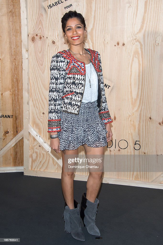 Freida Pinto attends the 'Isabel Marant For H&M' : Photocall At Tennis Club De Paris on October 24, 2013 in Paris, France.