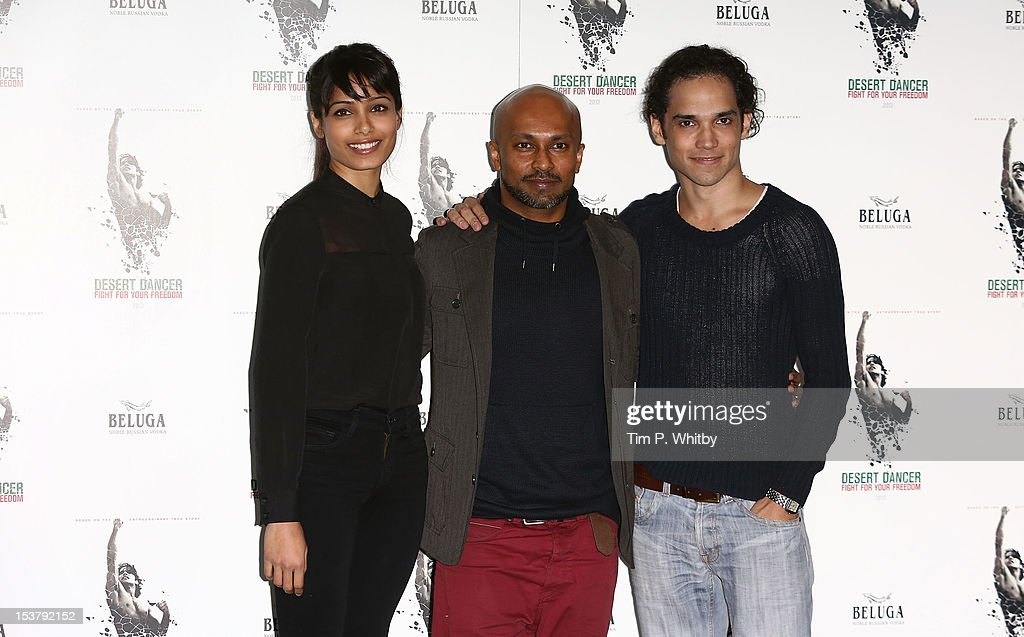 <a gi-track='captionPersonalityLinkClicked' href=/galleries/search?phrase=Freida+Pinto&family=editorial&specificpeople=5518973 ng-click='$event.stopPropagation()'>Freida Pinto</a>, choreographer Akram Khan and <a gi-track='captionPersonalityLinkClicked' href=/galleries/search?phrase=Reece+Ritchie&family=editorial&specificpeople=4938562 ng-click='$event.stopPropagation()'>Reece Ritchie</a> attend a photocall for 'Desert Dancer' at Sadler's Wells Theatre on October 9, 2012 in London, England.