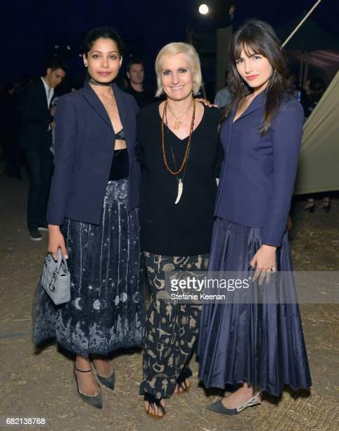 Freida Pinto Maria Grazia Chiuri and Camilla Belle at Christian Dior Cruise 2018 Show and After Party at Gladstone's Malibu on May 11 2017 in Malibu...