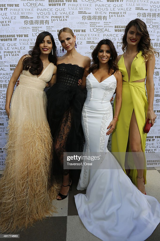 <a gi-track='captionPersonalityLinkClicked' href=/galleries/search?phrase=Freida+Pinto&family=editorial&specificpeople=5518973 ng-click='$event.stopPropagation()'>Freida Pinto</a>, <a gi-track='captionPersonalityLinkClicked' href=/galleries/search?phrase=Natasha+Poly&family=editorial&specificpeople=2163130 ng-click='$event.stopPropagation()'>Natasha Poly</a>, <a gi-track='captionPersonalityLinkClicked' href=/galleries/search?phrase=Eva+Longoria&family=editorial&specificpeople=202082 ng-click='$event.stopPropagation()'>Eva Longoria</a>, <a gi-track='captionPersonalityLinkClicked' href=/galleries/search?phrase=Isabeli+Fontana&family=editorial&specificpeople=220508 ng-click='$event.stopPropagation()'>Isabeli Fontana</a> attends the 'Saint Laurent' premiere during the 67th Annual Cannes Film Festival on May 17, 2014 in Cannes, France.
