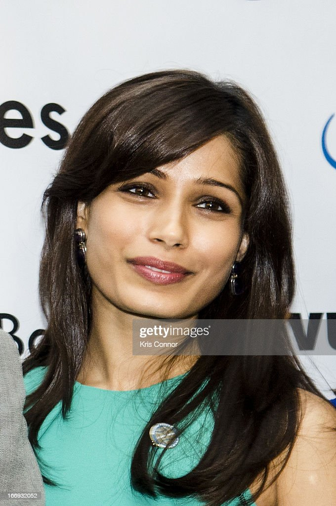 Freida Pinto poses for photos during the Girl Rising: A Rally for Girls and Women screening at The World Bank on April 18, 2013 in Washington, DC.