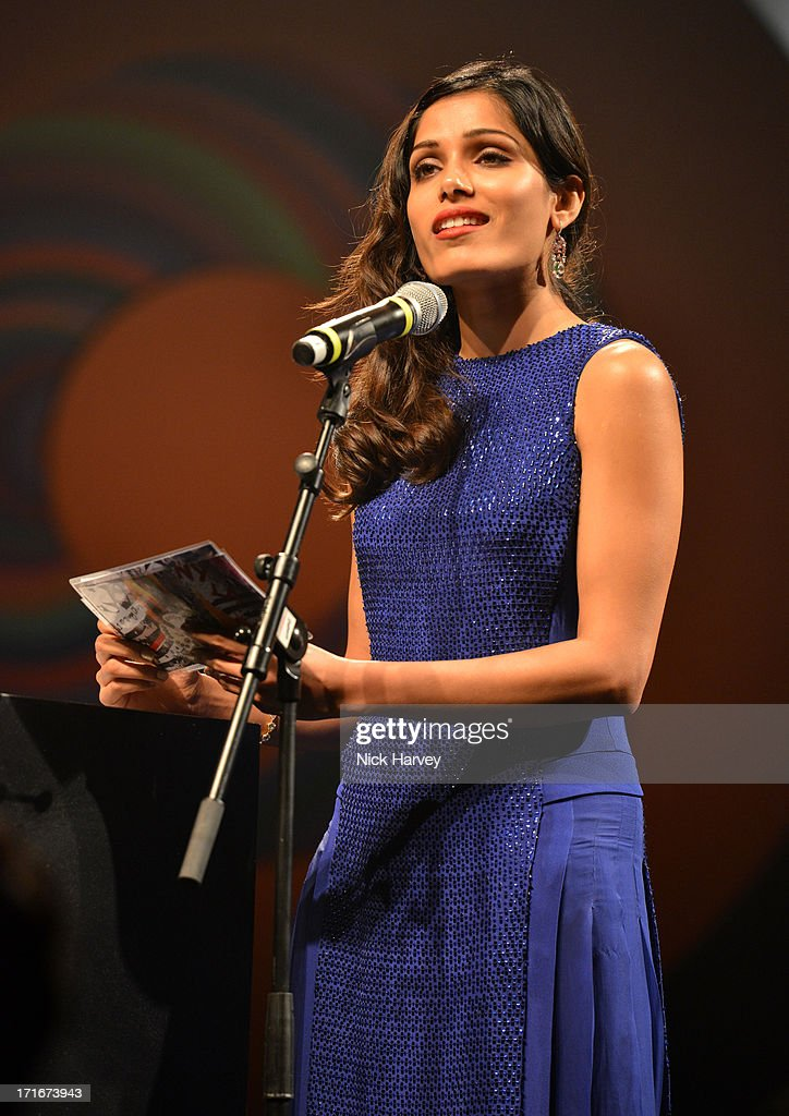 Freida Pinto speaks during the 15th Annual White Tie and Tiara Ball to Benefit Elton John AIDS Foundation in Association with Chopard at Woodside on June 27, 2013 in Windsor, England. No sales to online/digital media worldwide until the 14th of July. No sales before July 14th, 2013 in UK, Spain, Switzerland, Mexico, Dubai, Russia, Serbia, Bulgaria, Turkey, Argentina, Chile, Peru, Ecuador, Colombia, Venezuela, Puerto Rico, Dominican Republic, Greece, Canada, Thailand, Indonesia, Morocco, Malaysia, India, Pakistan, Nigeria. All pictures are for editorial use only and mention of 'Chopard' and 'The Elton John Aids Foundation' are compulsory. No sales ever to Ok, Now, Closer, Reveal, Heat, Look or Grazia magazines in the United Kingdom. No sales ever to any jewellers or watchmakers other than Chopard.