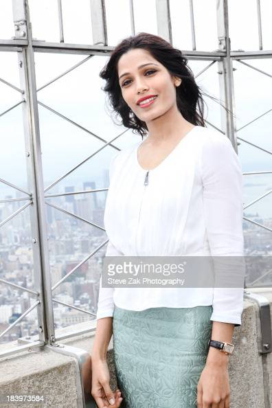 Freida Pinto visits the Empire State Building to honor 'International Day Of The Girl' October 10 2013 in New York City