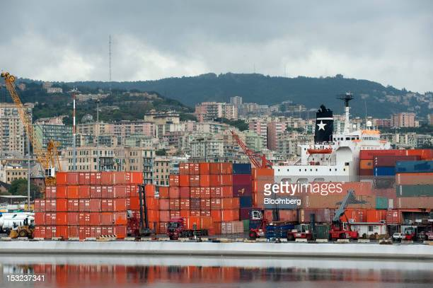Freight containers line the dock in front of the Jolly Grigio dry cargo ship operated by Ignazio Messina C SpA at Genoa port in Genoa Italy on Monday...