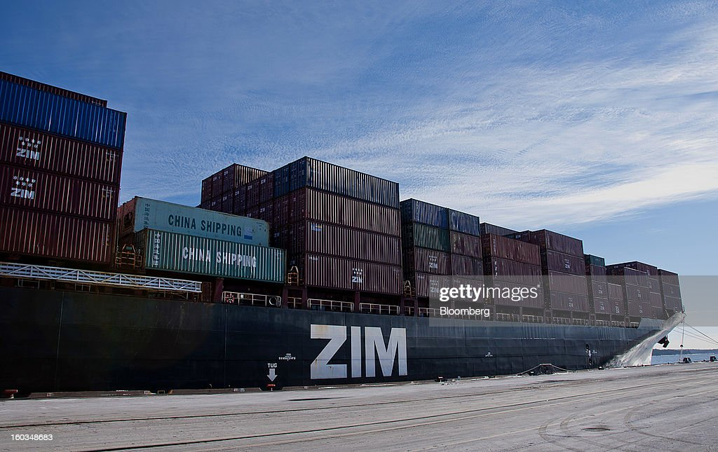 Freight containers sit stacked on a ZIM Integrated Shipping Services Ltd. ship at the Port Of Halifax's South End container terminal, operated by Halterm Ltd., in Halifax, Nova Scotia, Canada, on Tuesday, Jan. 29, 2013. Statistics Canada (STCA) is scheduled to release gross domestic product data on Jan. 31. Photographer: Aaron McKenzie Fraser/Bloomberg via Getty Images