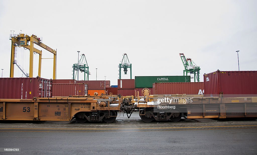 Freight containers sit stacked on truck for transport at the Port Of Halifax's Fairview Cove container terminal, operated by Cerescorp Co., in Halifax, Nova Scotia, Canada, on Wednesday, Jan. 30, 2013. Statistics Canada (STCA) is scheduled to release gross domestic product data on Jan. 31. Photographer: Aaron McKenzie Fraser/Bloomberg via Getty Images