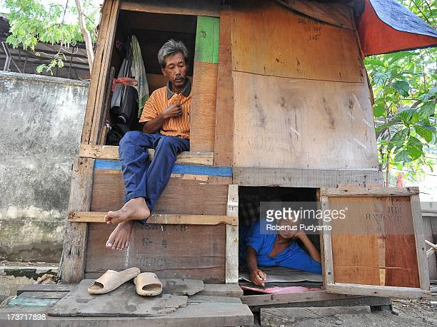 Freight laborers live in a hut made of plywood measuring 1 x 2 meters near Kalimas traditional harbor on July 17 2013 in Surabaya Indonesia Laborers...