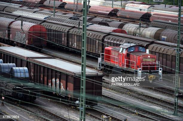 A freight locomotive can be seen at the train station in Hagen western Germany on May 19 2015 Train drivers of German railways operator Deutsche Bahn...