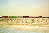 Freight locomotive moving through arid landscape, California, USA