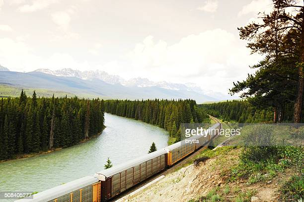 Freight train along  Bow River ,Bow Valley Parkway,Canada