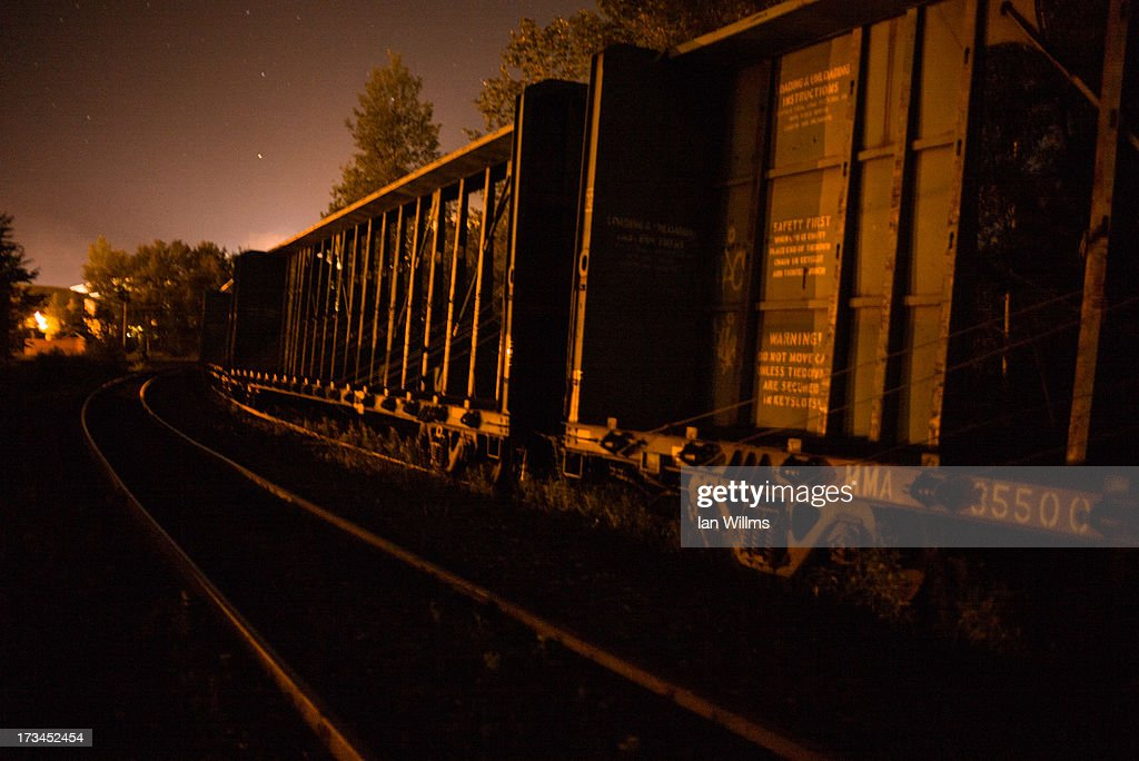 Freight train cars lay idle on the railway tracks on the outskirts on July 13, 2013 in Lac-Megantic, Quebec, Canada. A train derailed and exploded into a massive fire that flattened dozens of buildings in the town's historic district, leaving 60 people dead or missing in the early morning hours of July 6.
