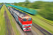 Freight train going in a hurry along the train at high speed. Railway Transport Concept