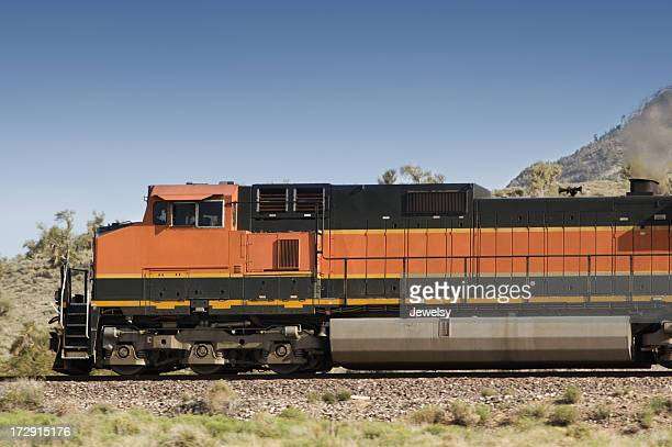 A freight train going past a mountain
