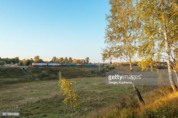 Freight train in the beautiful early autumn landscape