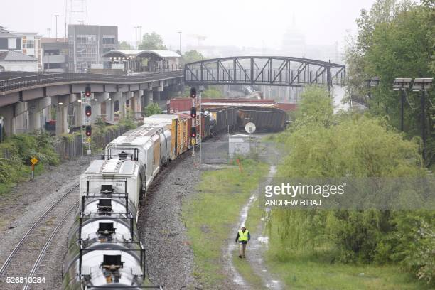 A CSX freight train is seen with several derailed cars near the Rhode Island Avenue metro station in Washington DC on May 1 2016 As many as ten cars...