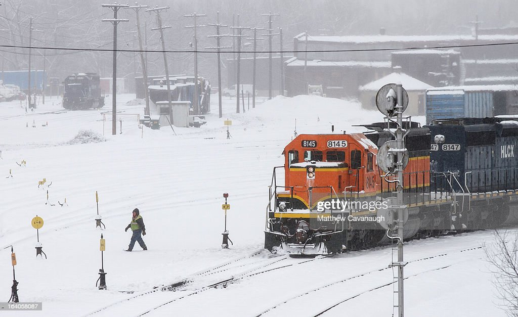 A freight train rolls down the tracks in the snowy East Deerfield Railroad Yards on March 19, 2013 in Deerfield, Massachusetts. Another winter storm blew through the Northeast yesterday, with snow and sleet closing schools in some areas and making for a messy morning commute.