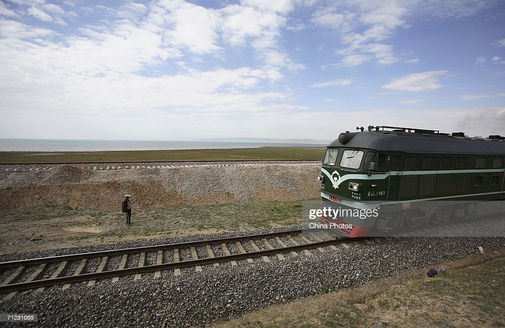 A freight train runs on the Xining-Golmud section of the Qinghai-Tibet Railway, on June 17, 2006 in Gangcha County of Qinghai Province, China. The Qinghai-Tibet railway will begin trial operations on July 1 and schedule has been set for the first five trains to Tibet via the new railway, an official with the Qinghai-Tibet Railway Company said. The 1,956-kilometer-long (about 1,215 miles) Qinghai-Tibet railway, linking Xining, capital of Qinghai Province, with Lhasa, capital of Tibet Autonomous Region, is the world's highest and longest plateau railroad and also the first railway connecting Tibet with other parts of China. Some 960 kilometers (576 miles) of its track are located 4,000 meters (13,120 feet) above sea level and the highest point is 5,072 meters (16,636 feet), according to state media.