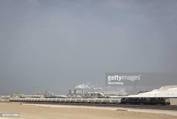 A freight train sits on the railway tracks outside the Ras Al Khair Industrial City operated by the Saudi Arabian Mining Co in Ras Al Khair Saudi...