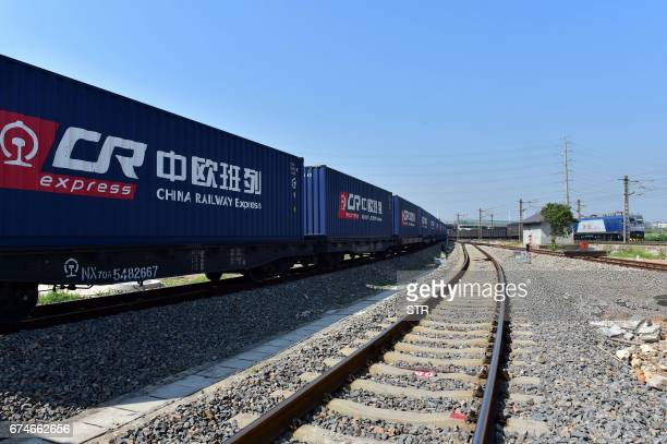 A freight train transporting containers laden with goods from London arrives at Yiwu railway port station in Yiwu east China's Zhejiang province on...