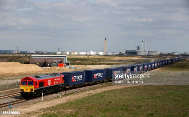 A freight train transporting containers laden with goods from the UK departs from DP World London Gateway's rail freight depot in Corringham east of...