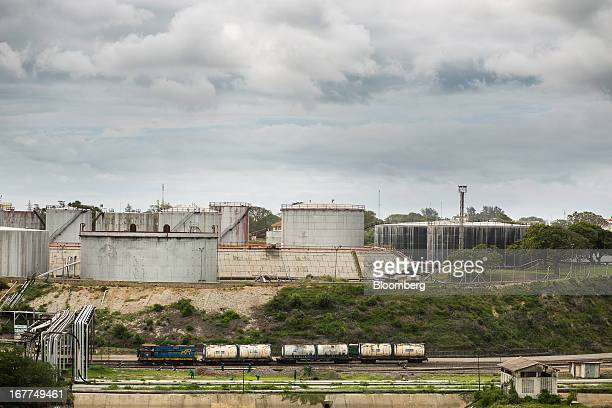 A freight train transports cooking oil past fuel storage tanks at Mombasa port managed by the Kenya Ports Authority a staterun company in Mombasa...
