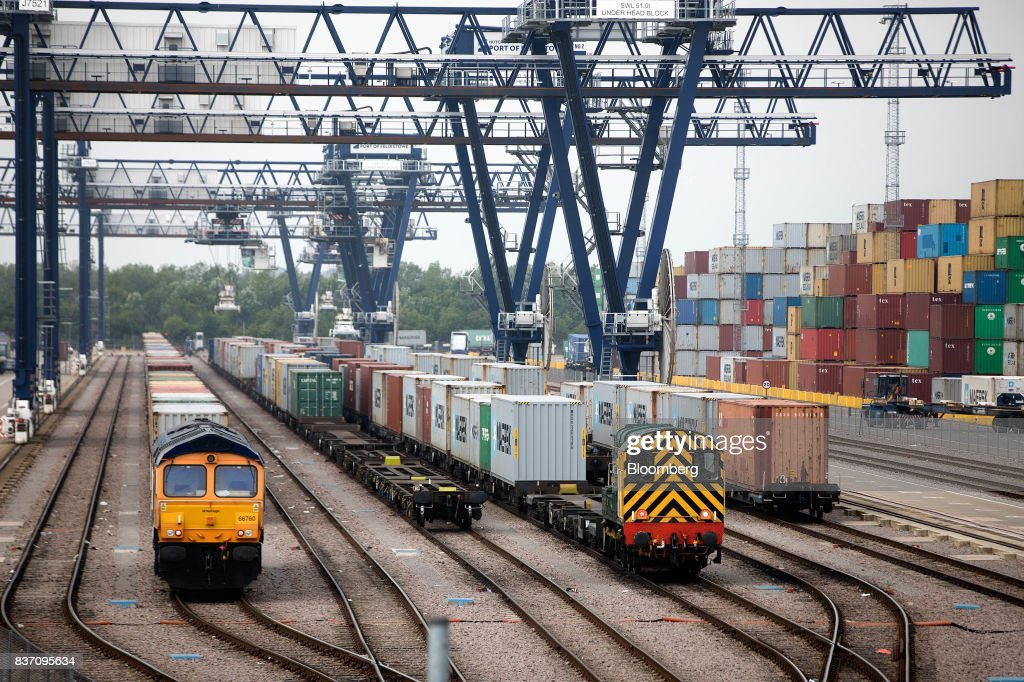 Freight trains await cargo loading at the Port of Felixstowe Ltd., a subsidiary of CK Hutchison Holdings Ltd. in Felixstowe, U.K., on Tuesday, Aug. 22, 2017. U.K. exporters are still reaping the benefits of a weaker pound, but they're not sure how long the boost will continue as the country gets closer to withdrawing from the European Union. Photographer: Simon Dawson/Bloomberg via Getty Images