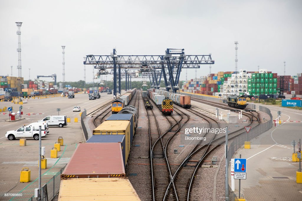 Freight trains stand at the Port of Felixstowe Ltd., a subsidiary of CK Hutchison Holdings Ltd. in Felixstowe, U.K., on Tuesday, Aug. 22, 2017. U.K. exporters are still reaping the benefits of a weaker pound, but they're not sure how long the boost will continue as the country gets closer to withdrawing from the European Union. Photographer: Simon Dawson/Bloomberg via Getty Images