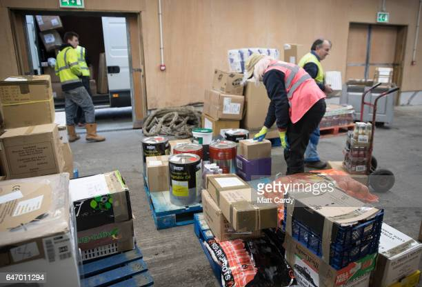 Freight unloaded from the ship Gry Maritha is sorted for delivery by van at St Mary's Quay on St Mary's on February 18 2017 in Cornwall England The...