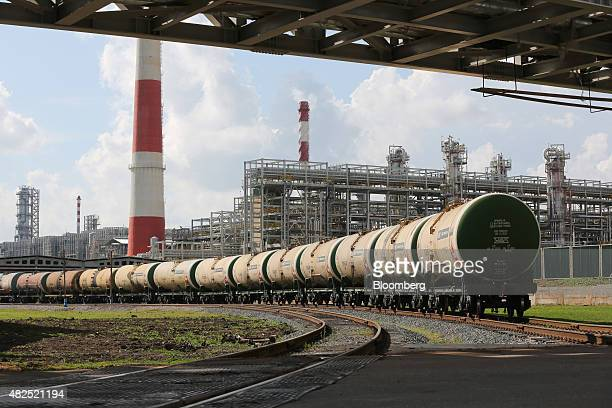 Freight wagons filled with petroleum fuel sit before shipping at the 'TANECO' refining and petrochemical plant operated by Tatneft OAO in...