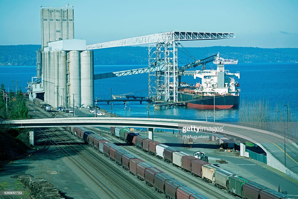 Freighter at grain loading facility in Tacoma WA : Stock Photo