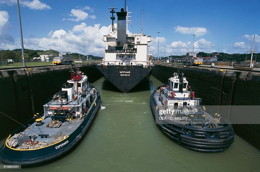 Freighter towed by two tugs Miraflores locks Panama canal Panama