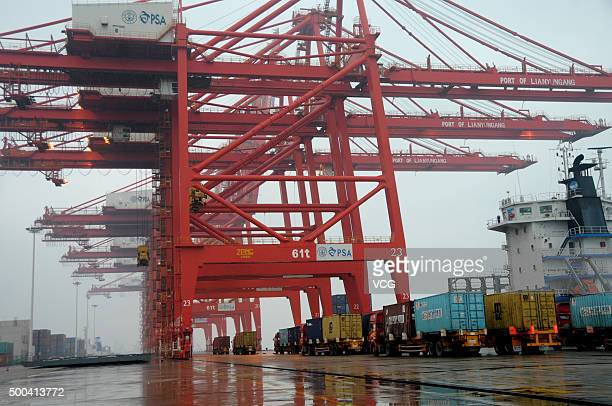 A freighter waits goods for exporting at a container terminal on December 8 2015 in Lianyungang Jiangsu Province of China The general administration...