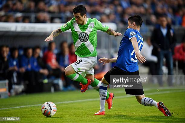 Freitas DeVieirinha of Wolfsburg and Dennis Mast of Bielefeld compete for the ball during the DFB Cup Semi Final match between Arminia Bielefeld and...