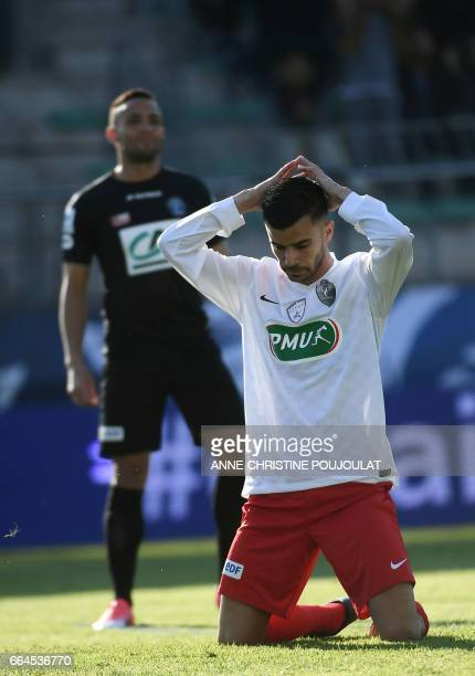 FrejusSaint Raphael's forward Karim Tlili reacts during the French Cup final quarter football match between FrejusSaint Raphael and Guigamp on April...