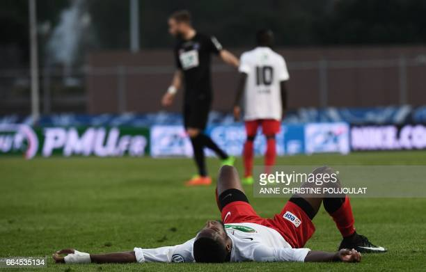 FrejusSaint Raphaël's defender Evander Moreira lies on the pitch after losing the French Cup football final quarter match between FrejusSaint Raphaël...
