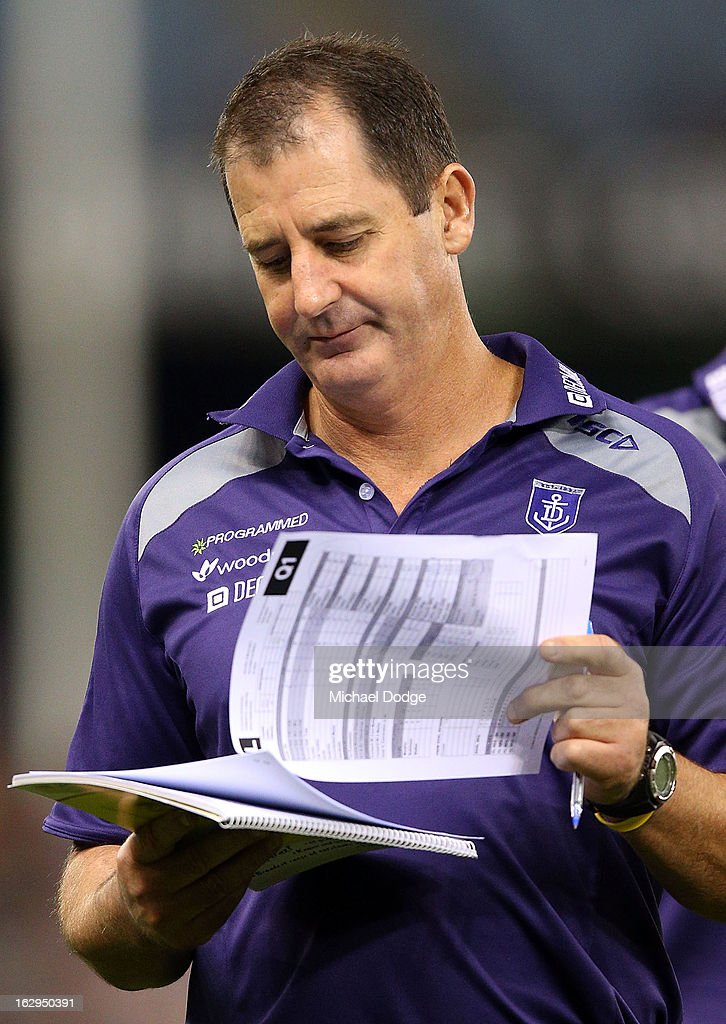 Fremantle Dockers coach Ross Lyon reads some player statistics during the round two AFL NAB Cup match between the Carlton Blues and the Fremantle Dockers at Etihad Stadium on March 2, 2013 in Melbourne, Australia.