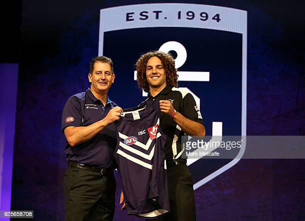 Fremantle Dockers head coach Ross Lyon poses with the number eight draft pick Griffin Logue of Fremantle Dockers during the 2016 AFL Draft at Hordern...