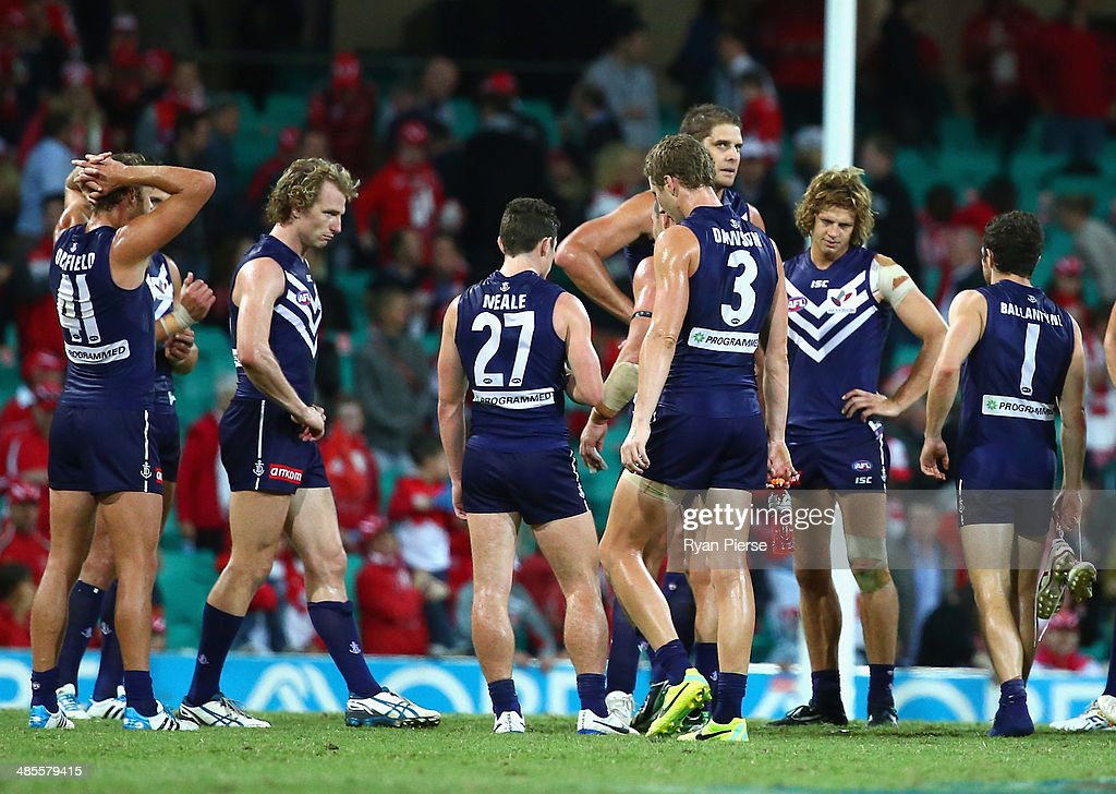 Fremantle players look dejected after the round five AFL match between the Sydney Swans and the Fremantle Dockers at Sydney Cricket Ground on April 19, 2014 in Sydney, Australia.