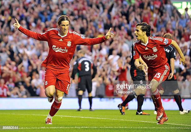 Frenando Torres of Liverpool celebrates with Yossi Benayoun after scoring the opening goal during the Barclays Premier League match between Liverpool...