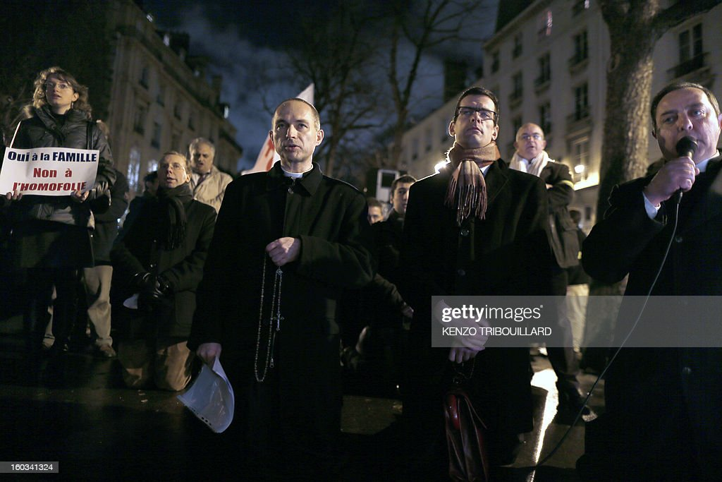 French abbot Xavier Beauvais, Prior of Saint-Nicolas-du-Chardonnet church (R) speaks during a protest organized by fundamentalist Christians group Civitas Institute against same-sex marriage on January 29, 2013 in Paris. France's parliament began today examining draft legislation on same-sex marriage after months of rancorous debate and huge street protests by both supporters and opponents. AFP PHOTO / KENZO TRIBOUILLARD
