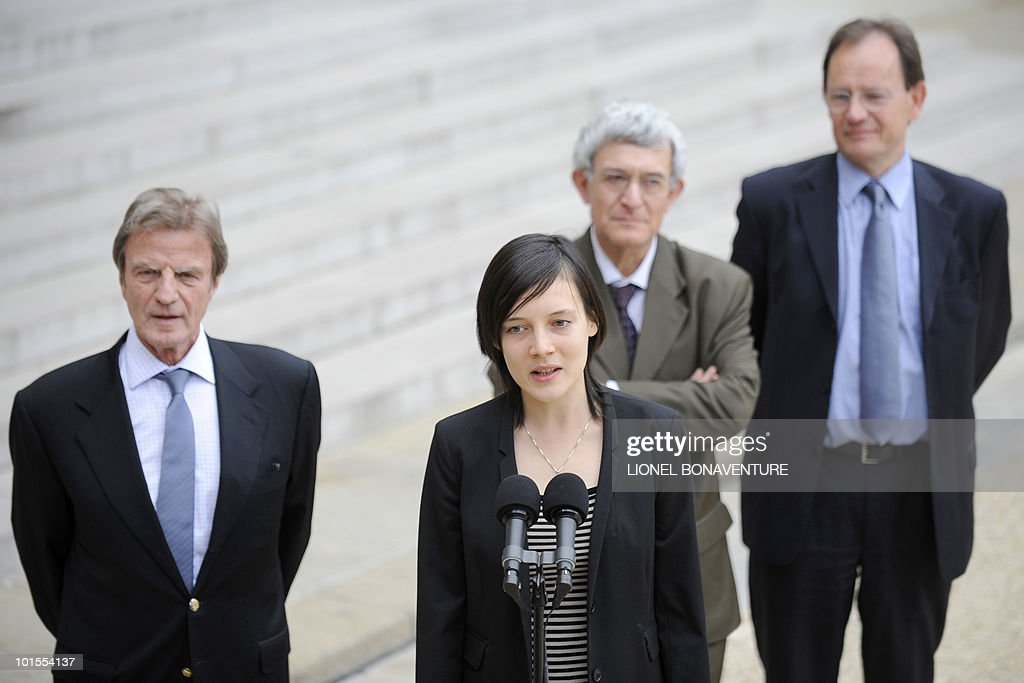French academic Clotilde Reiss (2nd L) speaks to journalists next to her father Remi Reiss (R), French ambassador to Iran Bernard Poletti (2nd R) and French Foreign Affairs minister Bernard Kouchner (R) at the Elysee Palace in Paris, after being received by French President Nicolas Sarkozy after her return from Teheran, on May 16, 2010. Reiss, who had been arrested and held in Iran since last July, left Tehran early Sunday for Paris a week after France rejected a US call for the extradition of Majid Kakavand and allowed him to return home.
