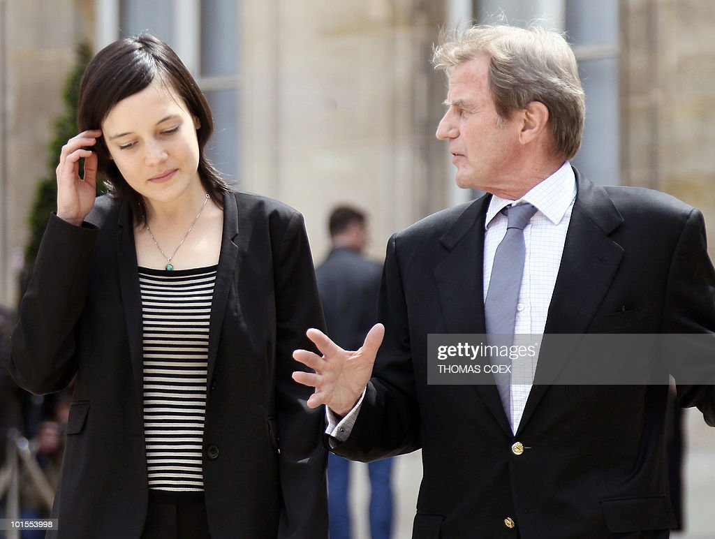 French academic Clotilde Reiss (L) speaks with French Foreign Affairs minister Bernard Kouchner as they leave the Elysee Palace in Paris, after being received by French President Nicolas Sarkozy after her return from Teheran, on May 16, 2010. Reiss, who had been arrested and held in Iran since last July, left Tehran early Sunday for Paris a week after France rejected a US call for the extradition of Majid Kakavand and allowed him to return home.